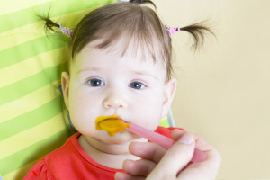 http://www.dreamstime.com/royalty-free-stock-photography-little-baby-girl-eating-vegetable-puree-image24910737